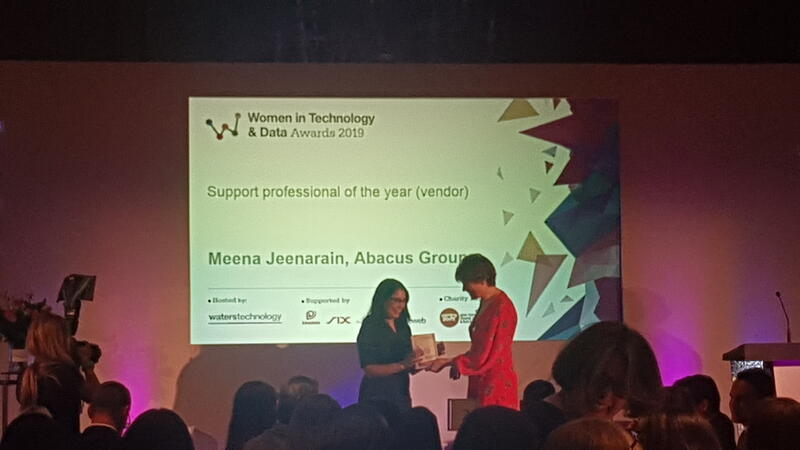 Meena Jeenarain accepting Women in Tech award at WatersTechnology luncheon in London