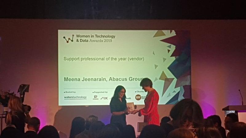 Meena Jeenarain accepting Women in Tech award at WatersTechnology luncheon in London